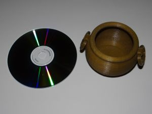 cauldron with a cd