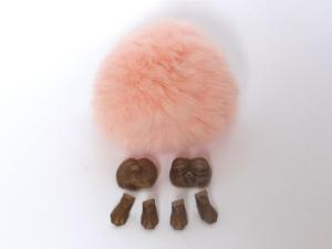 Pieces of the pygmy puff with a fur ball
